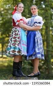 Two Young beautiful slovak women in traditional costume