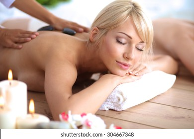 Two young beautiful women relaxing and enjoying at the spa