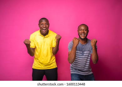 Two young black men happy over something they received