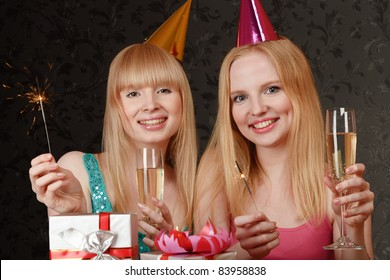 Two young blonde women celebrating birthday