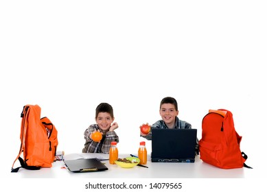 two young boys doing together studying and homework