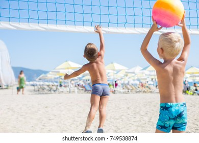 Two young boys playing Beach Volleyball