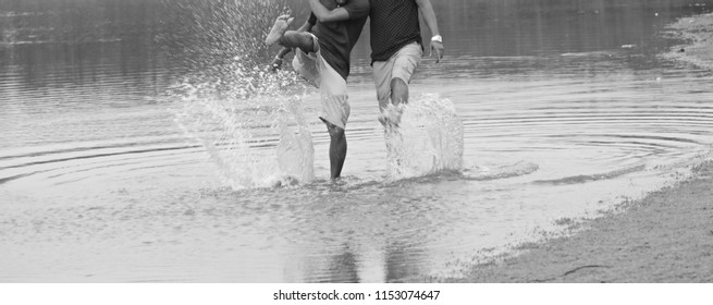 Two young boys playing in the lake water isolated unique blurry photo