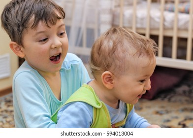 Two young brothers playing in their bedroom at home
