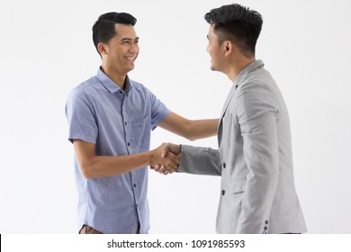 Two young business man make a deal with hand shaking