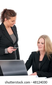 Two young business women working in the office with laptop
