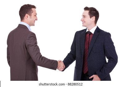 two young businessman handshake on business meeting over white background