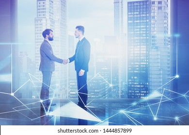 Two young businessmen shaking hands in modern panoramic office with cityscape with double exposure of network interface. Concept of hi tech start up. Toned image