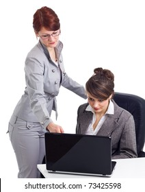 Two young businesswoman with laptop isolated over white