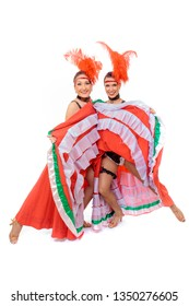 Two young cancan dancers girls lift up skirts flirting on a white background