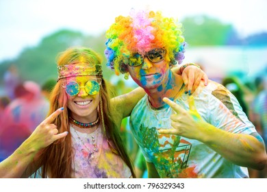 Two Young cheerful persons at Holi paint party