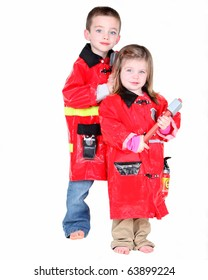 Two young children dressed as firemen on white background