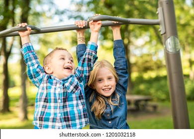 The Two young children having fun on the playground