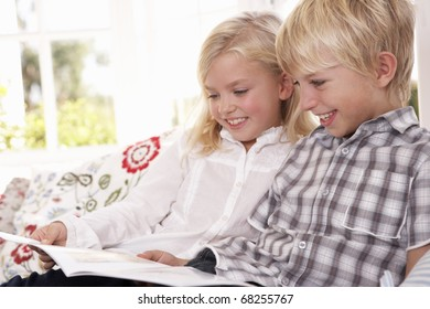 Two young children read together
