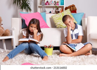 Two young children sick of learning