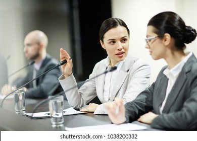 Two young confident businesswomen consulting about some working moments during conference