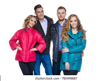Two young couples in winter clothes in a studio.Fashion shot.