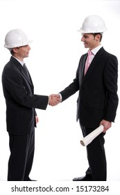 Two young Engineers closing a deal, isolated in background