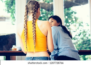 Two young female friends meting at cafe, coworking.