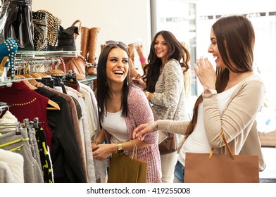 Two young female friends in a shopping, making fun.