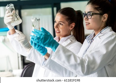 Two young female geneticists looking in plant samples.Agricultural laboratory.