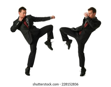 Two young fighting businessmen isolated on white
