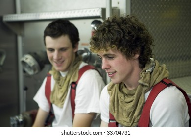 Two young Firemen talking about the fire