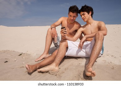 Two young friends relaxing at the beach