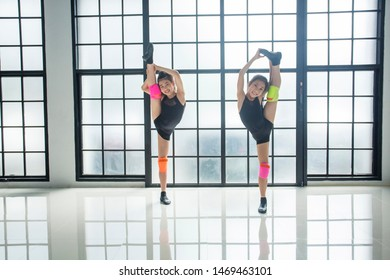 Two young girl dancers practicing modern dance practice in the classroom. and on training together  performing emotional contemporary dance in studio