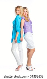 Two young girlfriends isolated on white background