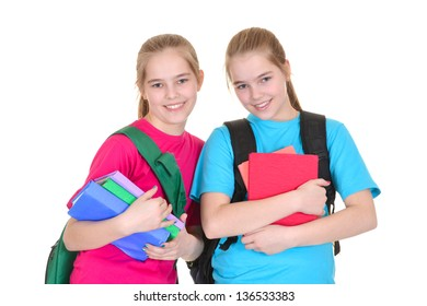 Two young girls with backpacks in colorful t-shirts on white background