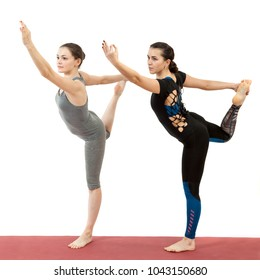 two young girls doing yoga