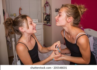 Two young girls fighting over a phone
