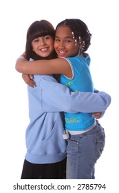 Two young girls hugging each other