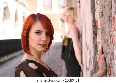two young girls near the old wall