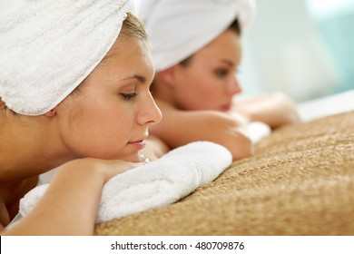 Two young girls relaxing at spa salon