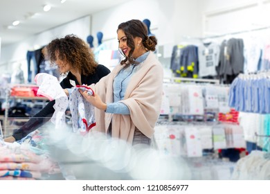 Two young girls shopping trendy kid clothes