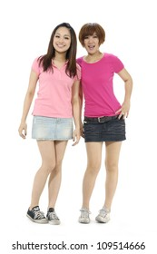 Two young girls standing isolated on white background