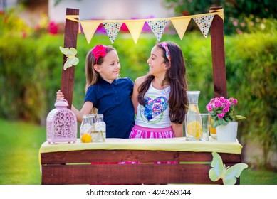 Two young girls at their lemonade stand
