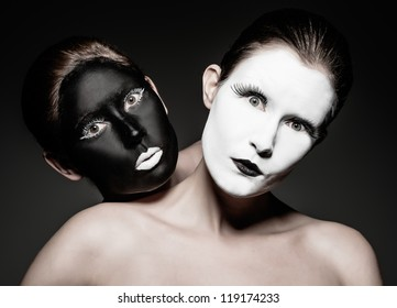 two young girls with ying yang style makeup