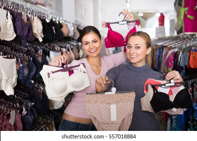 cbb42cfc7a1 Two young glad women shopping lace uplifts and panties together in lingerie  department