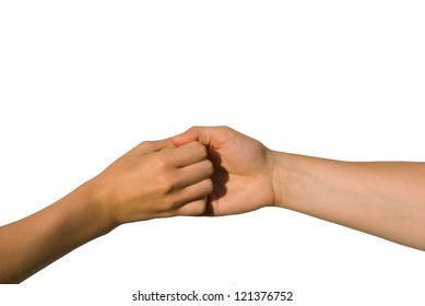 two young hands hold one another, isolated on white, aymbolizing team and strength