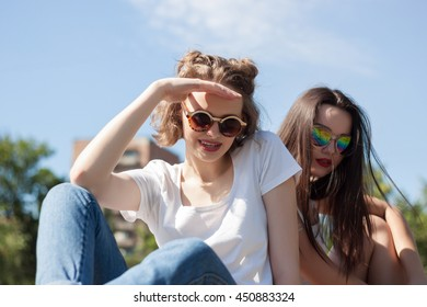Two young happy friends having fun in park outdoors in summer, teenage friendship concepts. Two Sisters playing and smiling