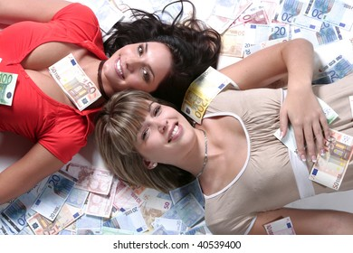 Two young happy and smiling women in money