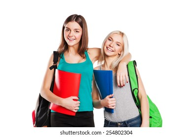 Two young happy students over white background