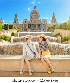 Two young happy women tourists friends travel in Barcelona, Spain