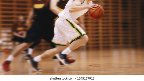 Two Young High School Basketball Players Playing Game. Youth Basketball Players Running in Motion Blur Durning Action. Basketball School Tournament