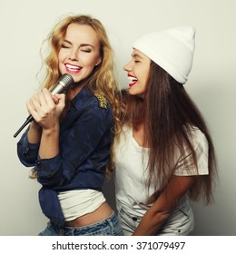 two young hipster blond girls singing