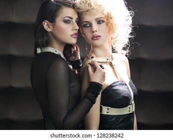 Two young ladies posing