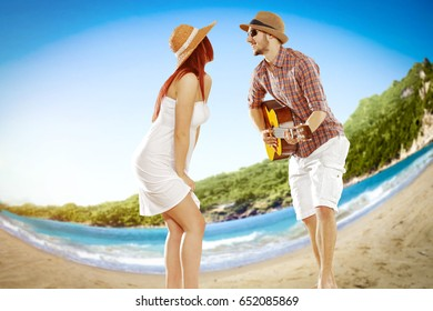 Two young lovers on beach and landscape of tropical beach with aberration